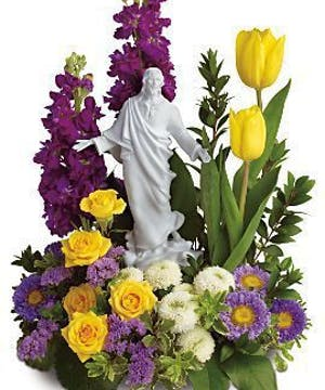 Flowers and a Porcelain Sculpture of Jesus